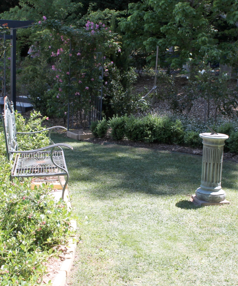 A seat and sundial.